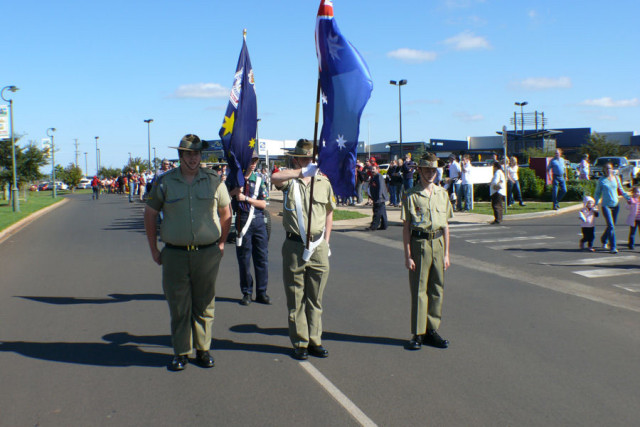 ANZAC Day March RSL Flag Parade Flagpoles White Flagpole Holders Ceremonial Cotton Gloves Highfields RSL Queensland